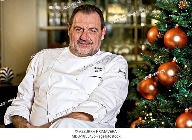 Italian chef Gianfranco Vissani posing beside a Christmas tree for a photocall shooted at his restaurant. Terni (Italy), 29th November 2013