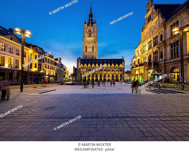 Belgium, Ghent, Sint-Baafsplein with belfry, cloth hall and theater at dusk