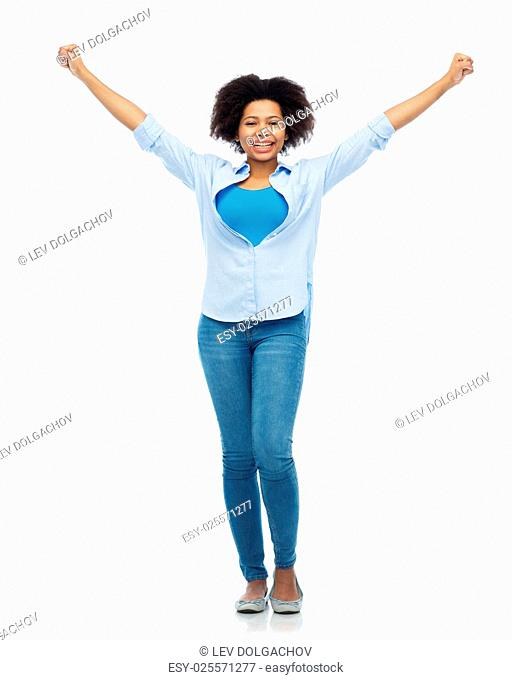 people, success and portrait concept - happy african american young woman with raised fists over white