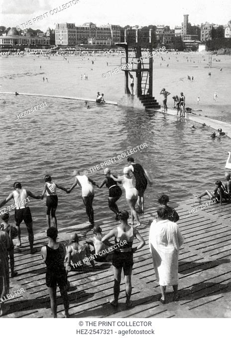 Bathing pool, Dinard, Brittany, France, 20th century. Stereoscope Camerascope card detail