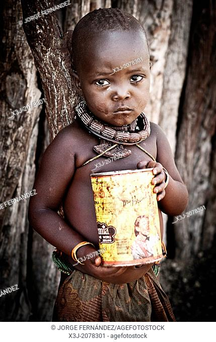Himba girl with can looking at the camera in a village near Epupa Falls, Kunene, Namibia, Africa