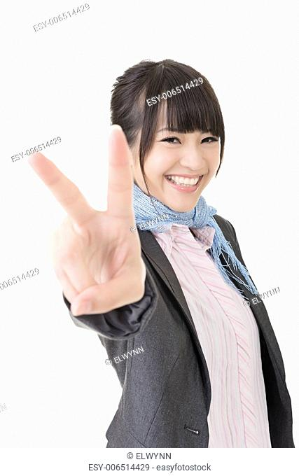 Asian business woman showing a gesture of peace. Closeup portrait. Isolated on the white background
