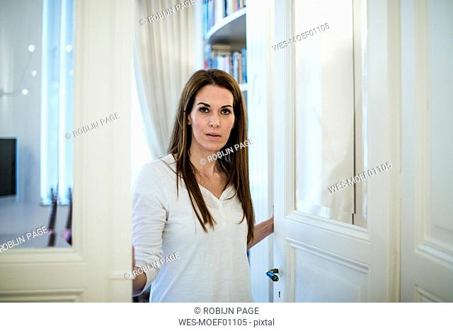 Portrait of woman at the door at home