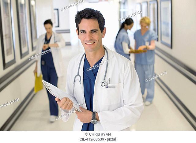 Portrait of smiling doctor in hospital corridor