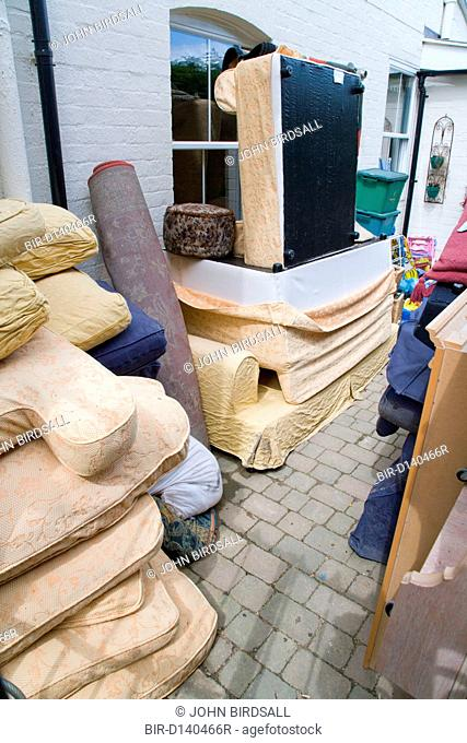 Damaged household goods and furniture piled up outside house after torrential rain caused the river Severn to bust its banks and flooded the Tewkesbury area