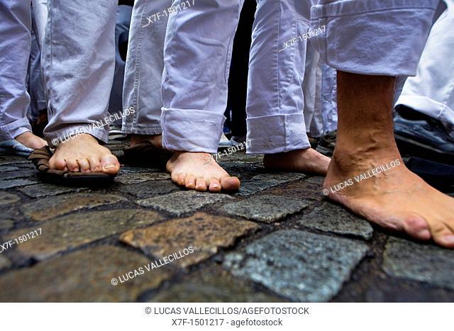 Feet of Minyons de Terrassa 'Castellers' building human tower, a Catalan tradition Fires i festes de Sant Narcis Plaça del Vi Girona Spain