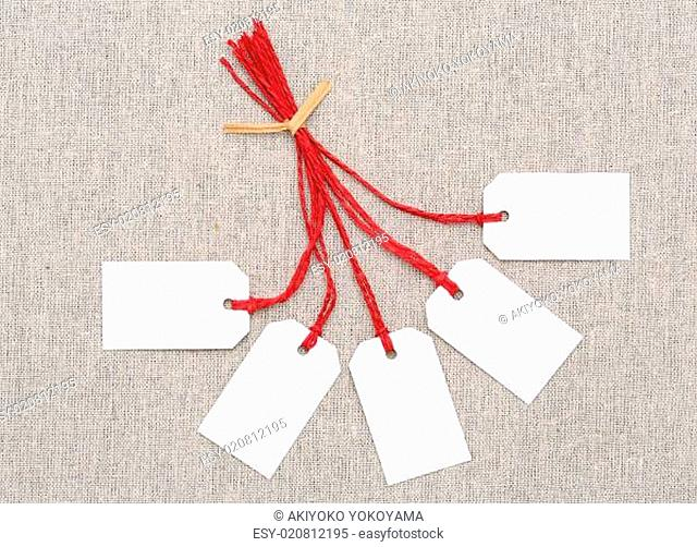 blank tag or label with red string