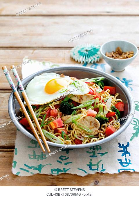 Bowl of chicken and egg with noodles