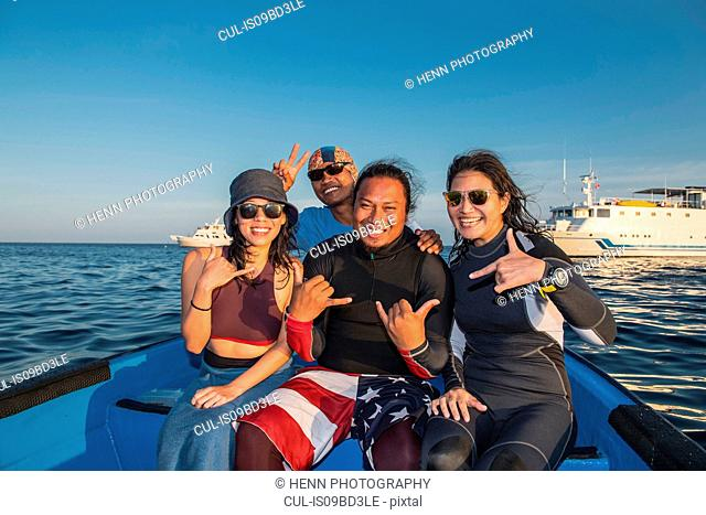 Divers enjoying dive boat trip, Tubbataha Reefs Natural Park, Sulu Sea, Philippines