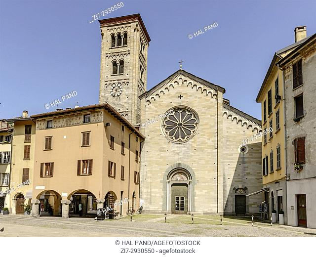 view of san Fedele Romanesque church and bell tower, shot in bright summer light at Como, Lombardy, Italy