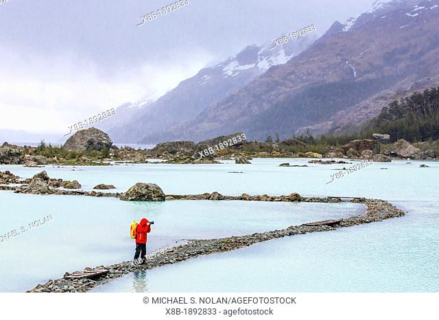 Hiker Carsten Peter on rocky path to the Bernal Glacier in Estero Las Montanas, Strait of Magellan, Patagonia, Chile