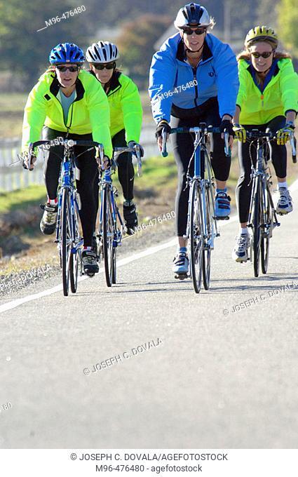 Four female bike riders. Hidden Valley. California. USA