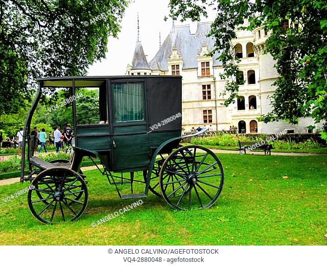 Ancient carriage in the garden of the Renaissance Château d'Azay-le-Rideau with its River Indre moat, Built between 1518 and 1527, Loire Valley, France