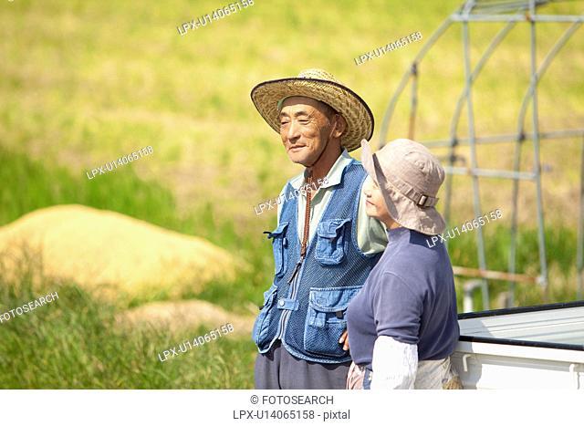 Senior Farmer Couple in Field