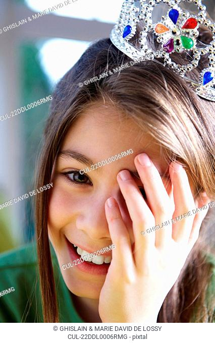 Girl wearing a crown, smiling