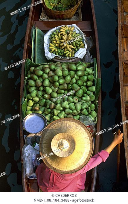 High angle view of a market vendor in a floating market, Thailand
