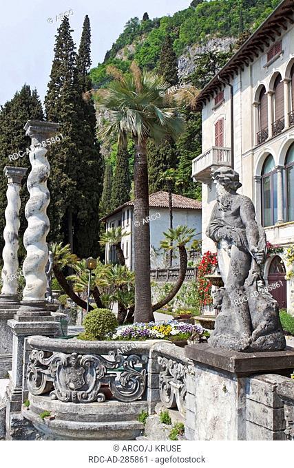 Statue and columns, botanical garden, Villa Monastero, Varenna, at Lake Como, province of Lecco, Lombardy, Italy / Lago di Como