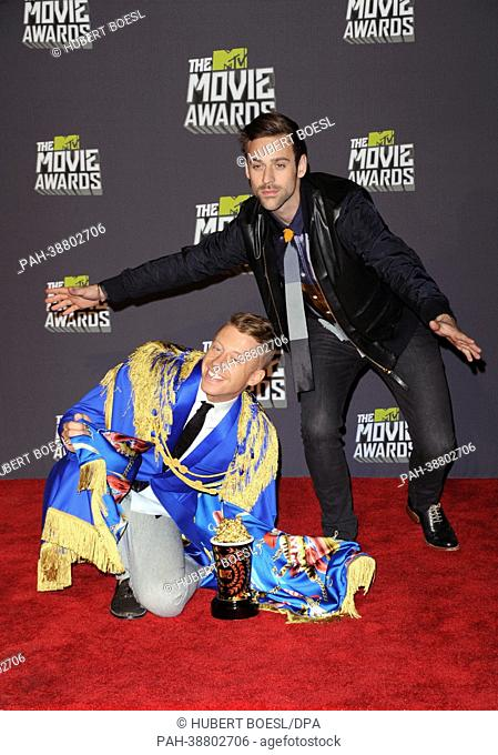 Musicians Macklemore (l) and Ryan Lewis pose at the 2013 MTV Movie Awards Photo Pressroom at Sony Pictures Studios in Culver City, Los Angeles, USA
