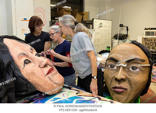 Seattle, Washington: Norma Baum, center, and volunteers work on the mask of Dolores Huerta at the Womxn's March Art Build at Urban ArtWorks