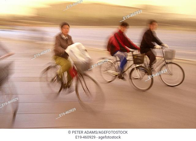 Cyclists in Tiananmen Square, Beijing. China