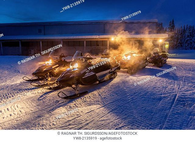 Snowmobiles in the freezing cold temperatures as low as -47 celsius. Lapland, Sweden