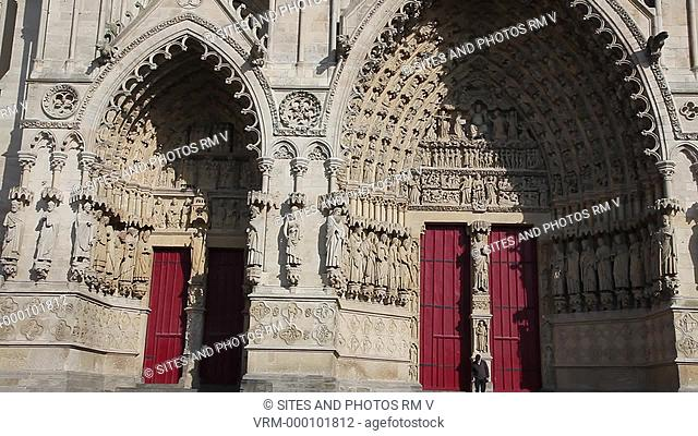 PAN. Daylight. Exterior: Doors of the West Facade. The Cathedral is in the High Gothic or Classical French style. It was built in the 13th century 1218-1269 to...