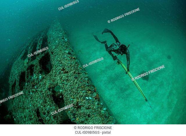 Spearfisherman looking for prey around wreck, Isla Mujeres, Quintana Roo, Mexico