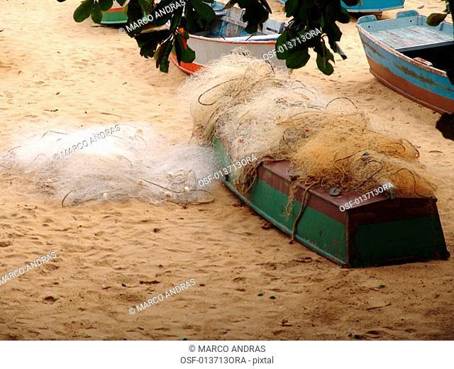 an overturned canoe on the sands