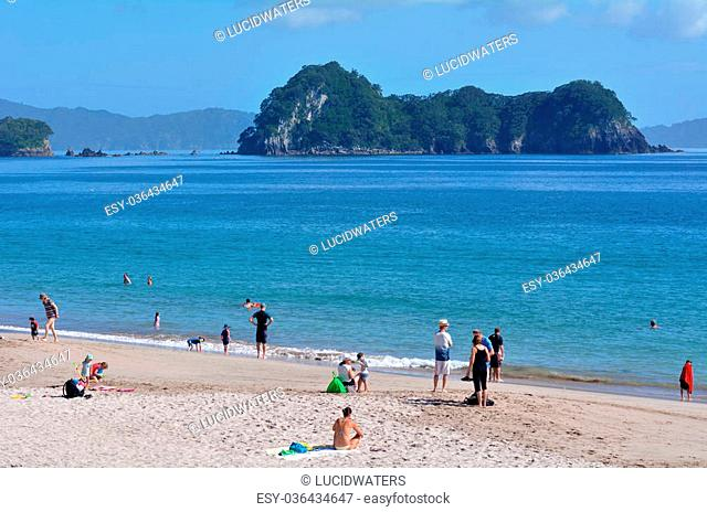 HAHEI, NZL - Jan 20 2015:Visitors in Hahei beach.The area is very popular tourists travel destination in New Zealand and receives around 150