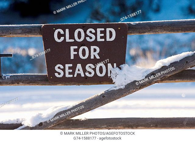 Closed for Season Sign in winter snow