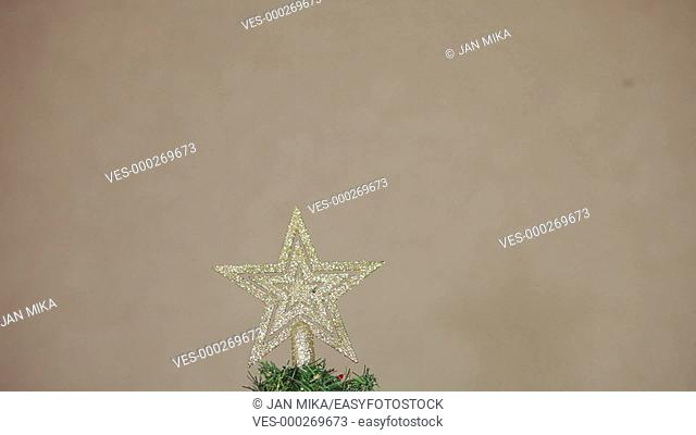 Artificial Christmas tree with golden decorations and lights, tilt movement