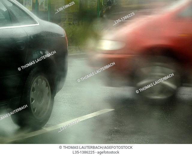 Cars with poor visibility in the rain