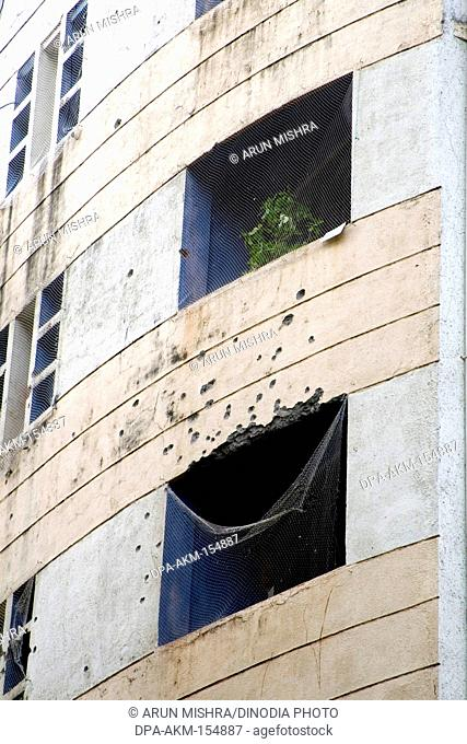 Windows broken by terrorists bomb attack near Nariman house in year 2008 ; Bombay Mumbai ; Maharashtra ; India