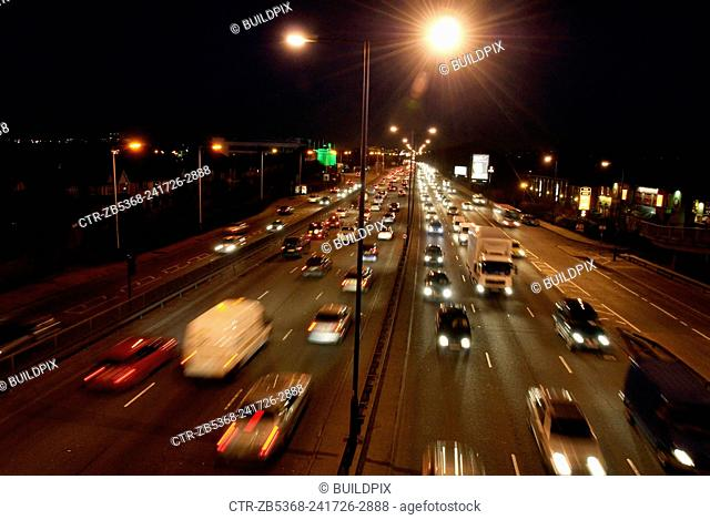 Road traffic on the A40 at night, London, UK