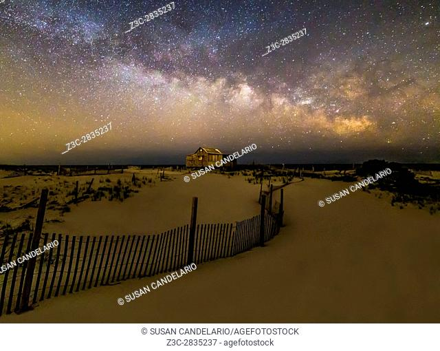 Jersey Shore Starry Skies and Milky Way - Island Beach State Park at the NJ Shore with beach fences leading to the Judge's Shack underneath a starry sky with...