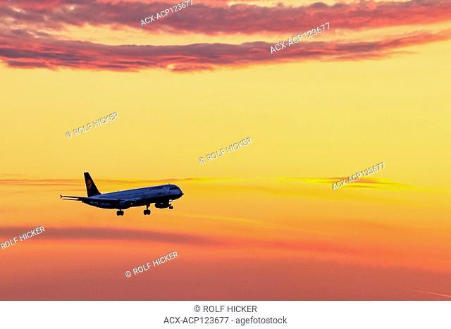 Lufthansa plane preparing landing on Munich Airport during a beautiful sunset. Munich Airport, Flughafen München, Franz Josef Strauss, near Freising / Erding