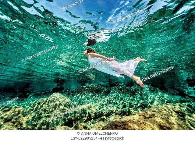 Swimming in transparent sea