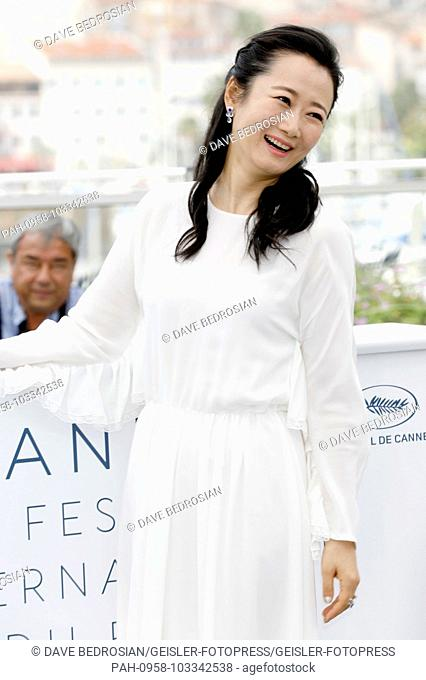 Tao Zhao at the 'Ash Is Purest White / Jiang hu er nv' photocall during the 71st Cannes Film Festival at the Palais des Festivals on May 12, 2018 in Cannes