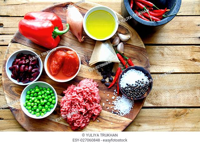 Chilli Con Carne Recipe. Ingredients on a wooden plate
