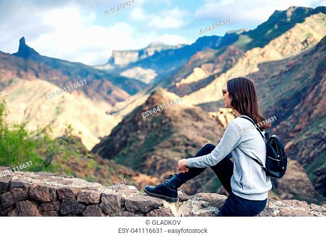 Beautiful woman relaxing on mountains. Vacation concept