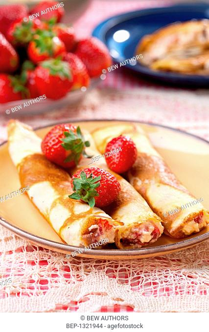 Crepes with cottage cheese and strawberries