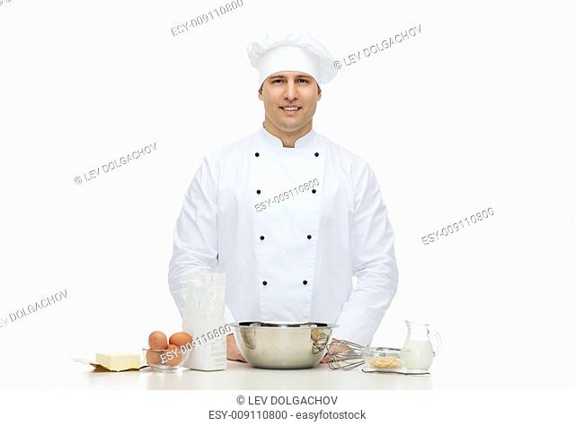 cooking, profession, haute cuisine, food and people concept - happy male chef cook baking