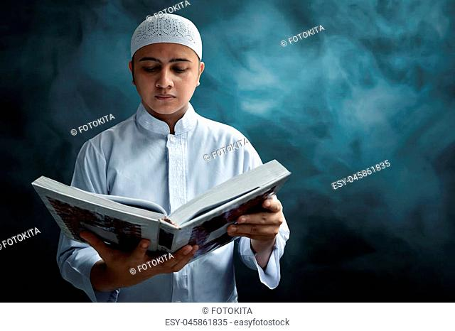 Muslim man reading koran