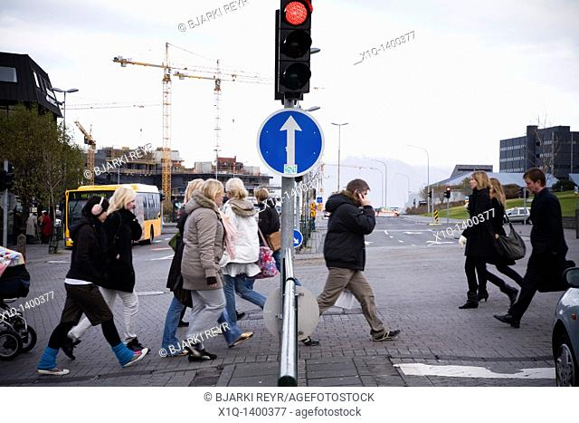 Reykjavik, Iceland, October 14: Pedestrians crossing the road on a cold autumn day in downtown Reykjavik
