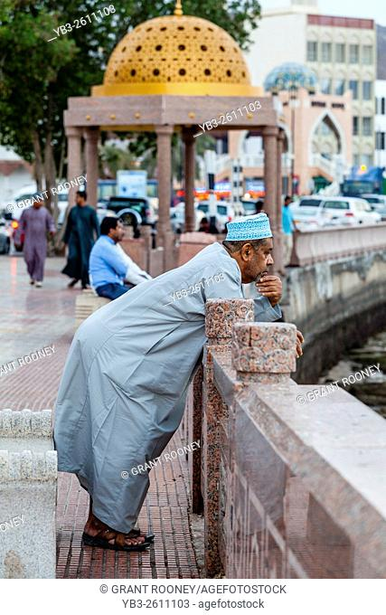 A Local Man Looks Out To Sea On The Corniche (Promenade) Muscat, Sultanate Of Oman