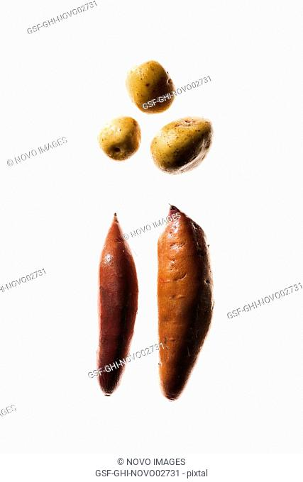 Yams and Potatoes on White Background