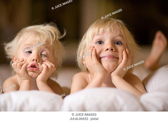 Two children making silly faces