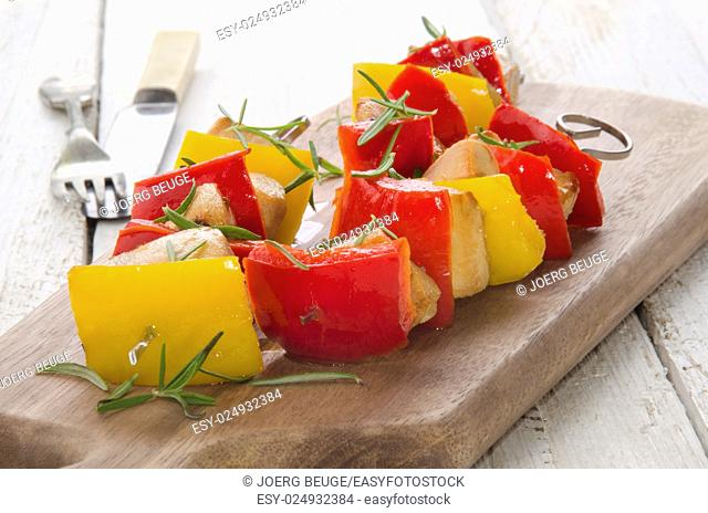 peppers shashlik with grilled chicken cubes on wooden board
