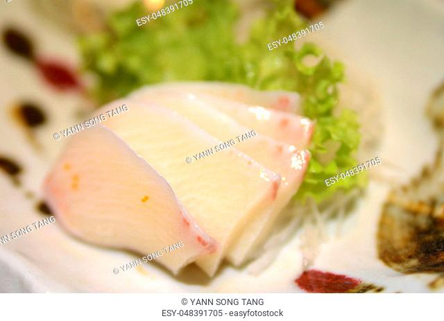 Raw fish yellowtail Stock Photos and Images | age fotostock