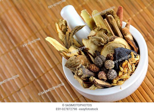 Assortment of Traditional Chinese herbal tea (Medicinal herbal tea) in a mortar